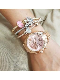 Reloj oro rosa números romanos y pulsera triple tres oros